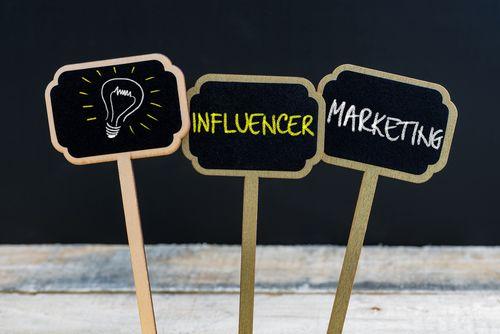 Concept Message Influencer Marketing And Light Bulb As Symbol Fo